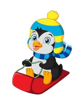 丘をそりで滑るかわいいペンギン