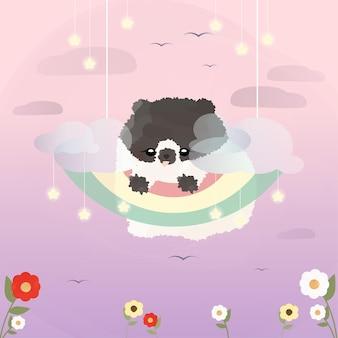 Милый маленький померанский щенок висит на радуге