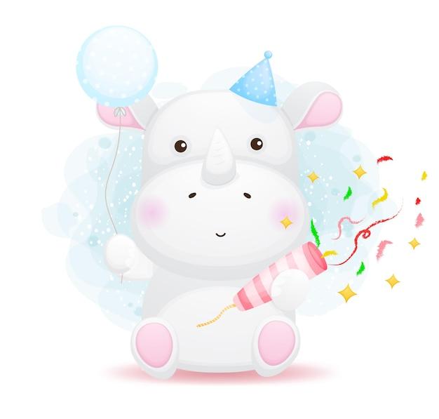 파티 포퍼를 해제하고 풍선 만화를 들고 귀여운 작은 코뿔소