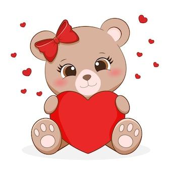 Милая маленькая медведица держит сердце