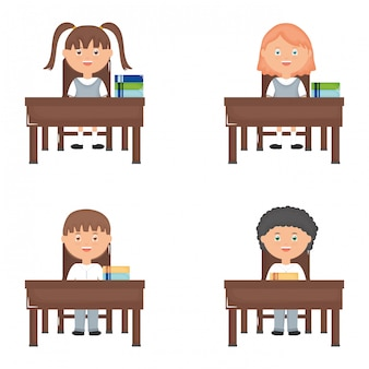 Cute little students group in the schooldesks