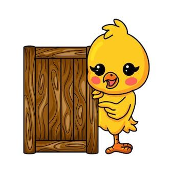 木の板とかわいい小さな黄色のひよこの漫画