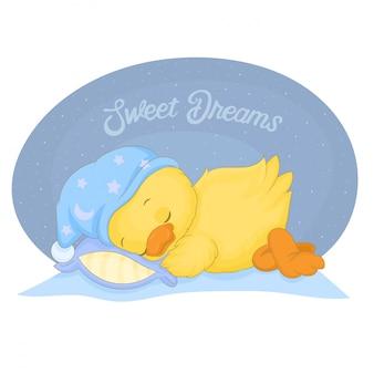 Cute little yellow duck in a blue hat sleeping