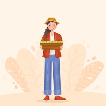 Cute local farmer holding box with fruits