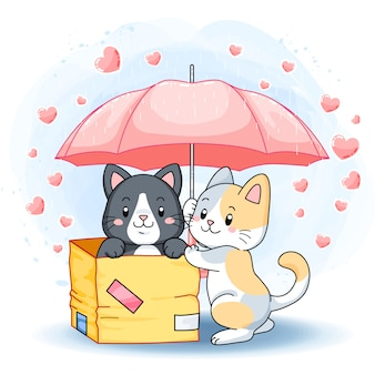 Cute lovely kittens under a pink umbrella in a rainy day