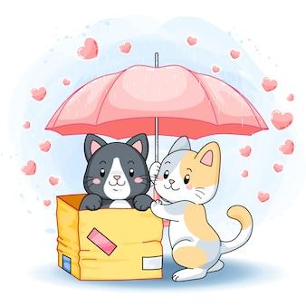 비오는 날에 분홍색 우산 아래 귀여운 사랑스러운 새끼 고양이