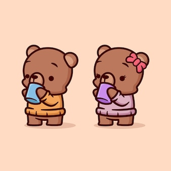Cute male and female brown bear drinks hot chocolate