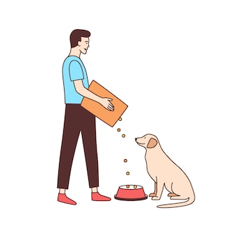 Cute male volunteer feeding stray dog in animal shelter or pound. young man giving food to homeless or abandoned doggy isolated