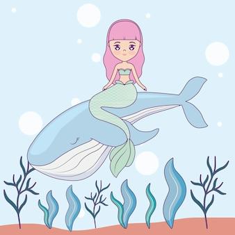 바다에서 고래를 가진 귀여운 인어