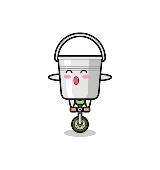 The cute metal bucket character is riding a circus bike , cute style design for t shirt, sticker, logo element