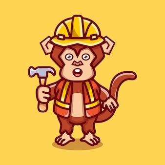 망치를 들고 귀여운 원숭이 빌더
