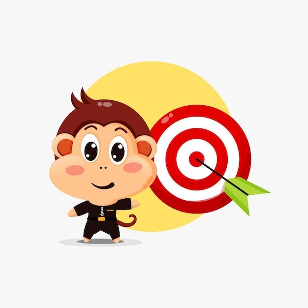 Cute monkey character showing arrow hitting target