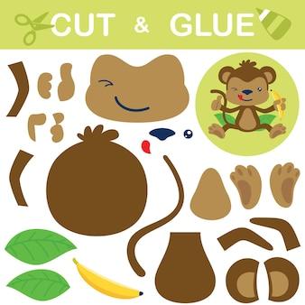 Милая обезьяна сидит на листе, держа банан. бумажная игра для детей. вырезка и склейка.