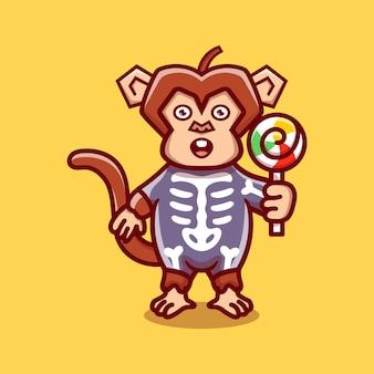 Cute monkey wearing skeleton halloween costume and carrying lollipop