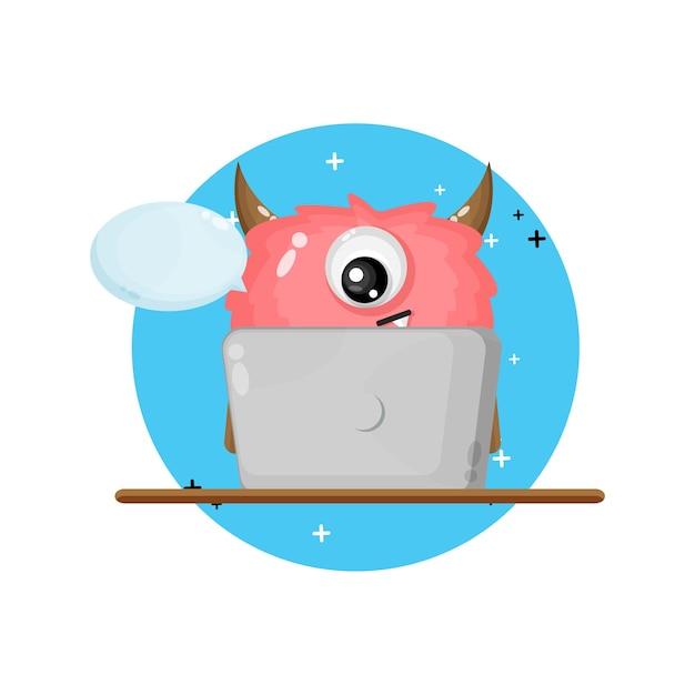 Cute monster mascot using laptop