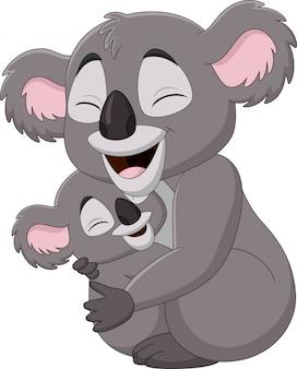 かわいい母コアラと赤ちゃんを抱いて