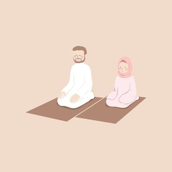 かわいいイスラム教徒のカップルが祈りマットで一緒にシャラットを祈る