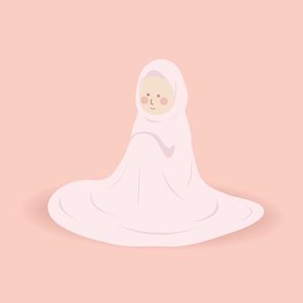 ピンクの祈りの服を着たかわいいムスリムの姉妹ムケナはアッラーを崇拝する行為で祈りをします