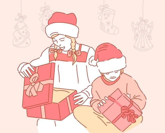 빨간 산타 모자에 귀여운 좋은 여자는 휴일에 크리스마스 선물 상자를 개최. 새해 복 많이 받으세요. 여자들은 크리스마스 선물을 엽니 다.