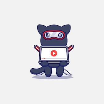 Милый кот ниндзя играет в видео с ноутбуком