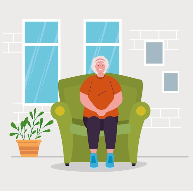 Cute old woman sitting in sofa, in house interior