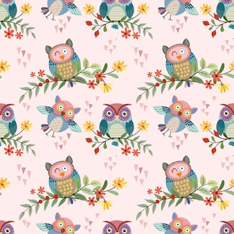Cute owl on branch with flowers seamless pattern vector design.