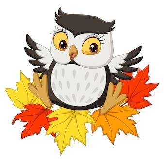秋の葉の上に座ってかわいいフクロウ漫画
