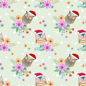 Cute owl wear christmas hat on branch with flower seamless pattern.