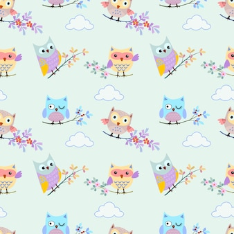 Cute owl with branch on blue sky and cloud seamless pattern