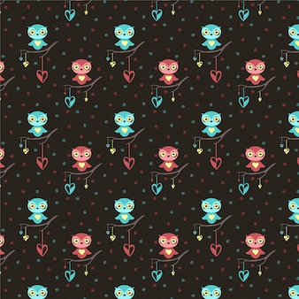 Cute owls, hearts seamless pattern on dark background for valentine's day