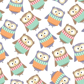 Cute owls in the winter clothes seamless pattern. vector illustration