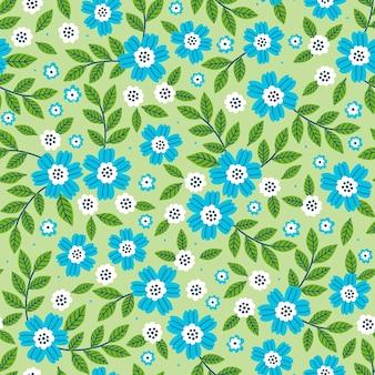 小さな青い花のかわいいパターン。薄緑色の背景。シームレスな花柄。