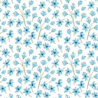 Симпатичный узор в маленьких синих цветках. белый фон. бесшовный цветочный узор.