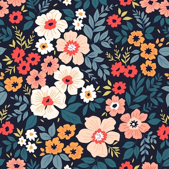 Cute pattern in small colorful flowers dark blue background seamless floral pattern