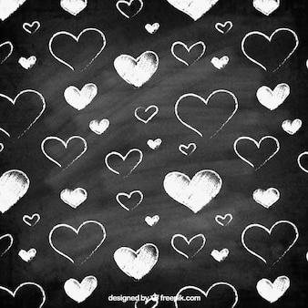 Cute pattern of white hearts and blackboard background