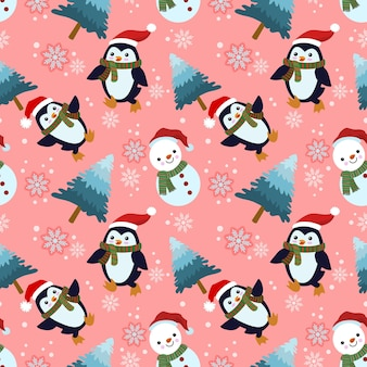 Милый пингвин и снежный человек носят рождественскую шапку зимой бесшовные модели.