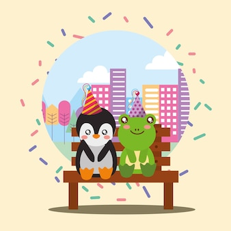 Cute penguin and frog sitting in bench the city
