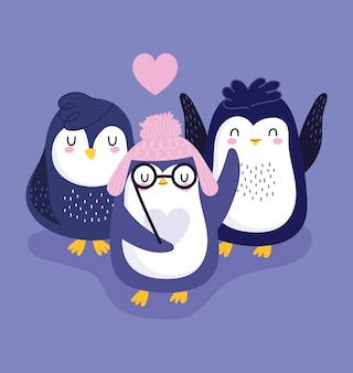 Cute penguins in warm hats and glasses