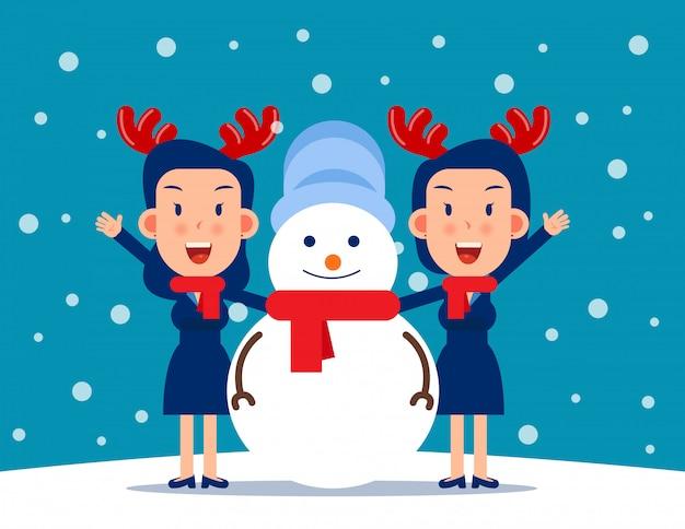 Cute person and a snowman. winter season concept