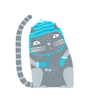ウールの冬服に座っているかわいいペットの子猫。