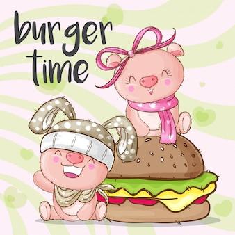 かわいいブタの動物とハンバーガー