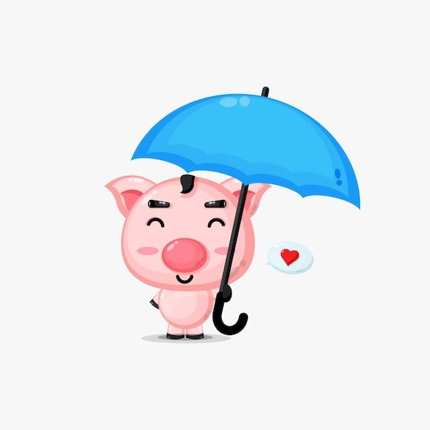 우산을 들고 귀여운 돼지