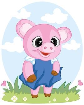 Милая свинья на весенней зеленой траве.