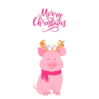 Cute pig sitting in a scarf and with deer horns with a garland. merry christmas hand lettering. greeting card for new year. funny piggy