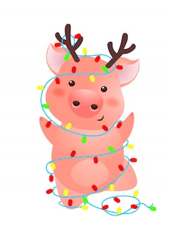 Cute pig with antlers wrapped into christmas lights