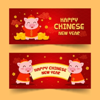 Cute pig with gold chinese new year banners