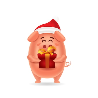 Cute pig with red cap carrying a gift box for christmas with isolated