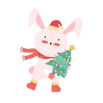 サンタの帽子とクリスマスツリーとかわいいピンクの赤ちゃんウサギ。分離された面白い漫画の動物