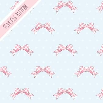 かわいいピンクの弓のシームレスなパターン