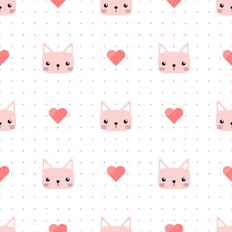 心とドットのシームレスパターンを持つかわいいピンク猫子猫